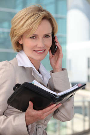Businesswoman smiling on mobile phone Stock Photo - 10854192