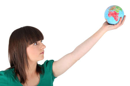 Girl holding the world in the palm of her hand Stock Photo - 10852174