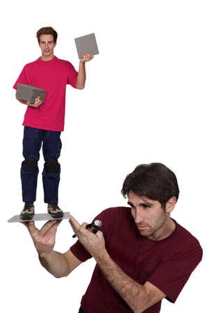 man in burgundy shirt carrying boy in fuchsia shirt on flagstone Stock Photo - 10851869