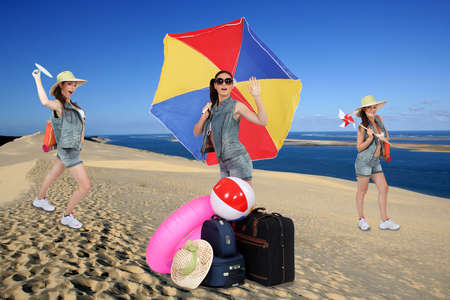 playing in the sea: Photo-montage of funny girl with parasol at the beach Stock Photo