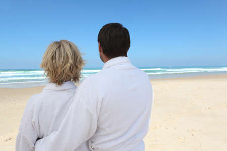 couple looking at the beach photo