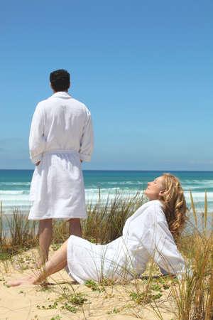Couple enjoying seaside break photo