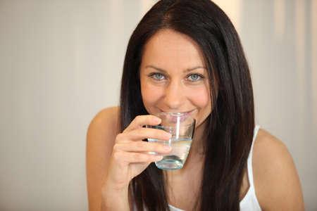 brunette woman drinking water Stock Photo - 10852962