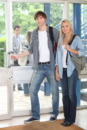 Young students leaving building photo
