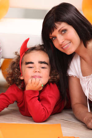 make belief: Mother with her daughter at Halloween Stock Photo