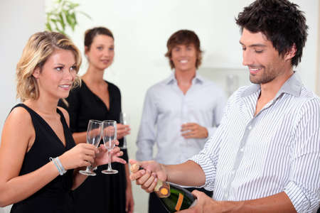 popping: Popping the champagne Stock Photo