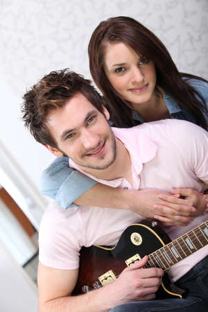 Young woman and young man with guitar Stock Photo - 10854943