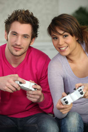 a couple playing video games photo
