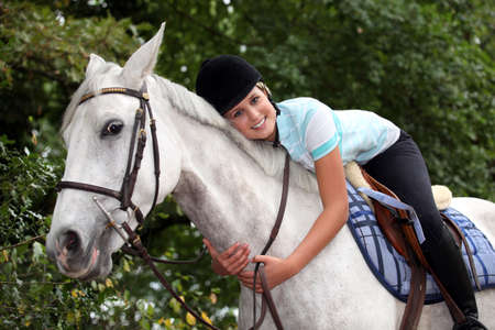 dappled: Young woman hugging her horse