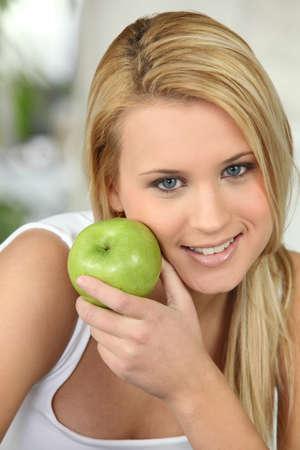 generosity: hermosa mujer rubia y una manzana