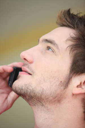 Close-up of man on mobile telephone Stock Photo - 10854319