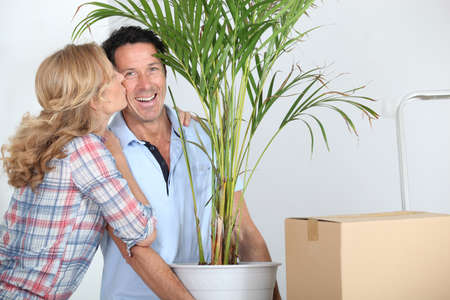 Couple moving in with plant Stock Photo - 10854944