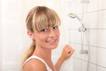blonde woman in bathroom photo