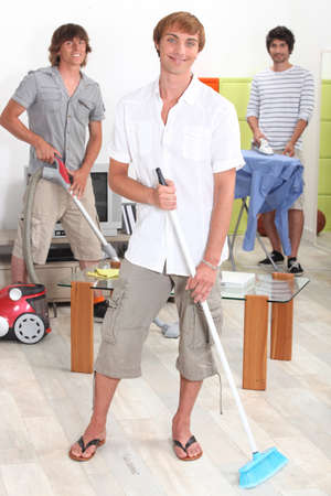 doing chores: Young men doing household chores