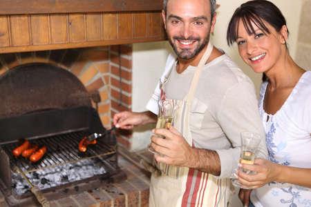 couple having nice time near the fireplace photo