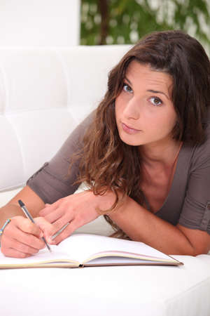 Woman writing in her journal Stock Photo - 10852733