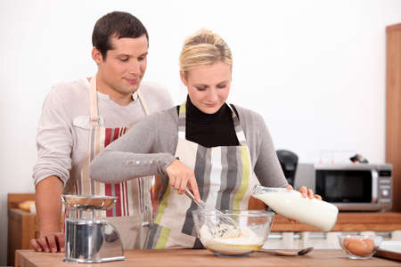 making face: Couple baking together