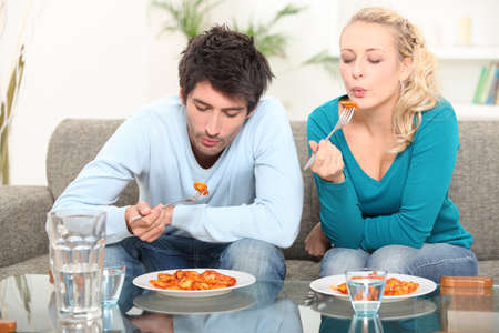 Couple eating meal at home Stock Photo - 10854599