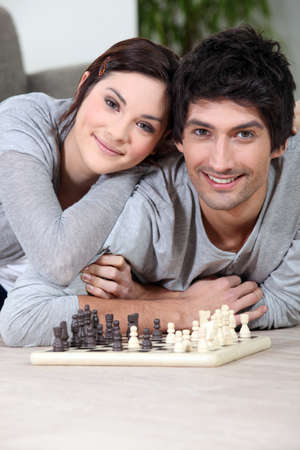 predict: Couple playing chess