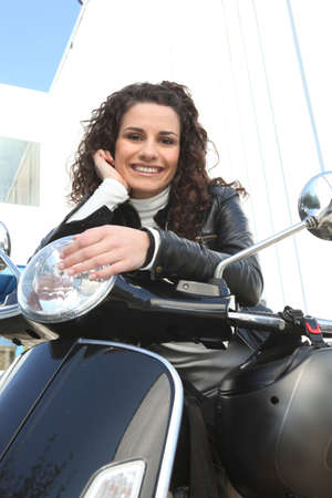 Woman riding a motorcycle photo