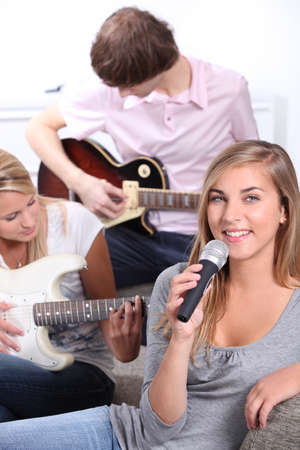 vocalist: Teenagers playing musical instruments