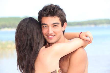 17 20: teenage couple at beach Stock Photo