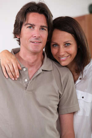 aplomb: a 35 years old woman putting her arm around her husband