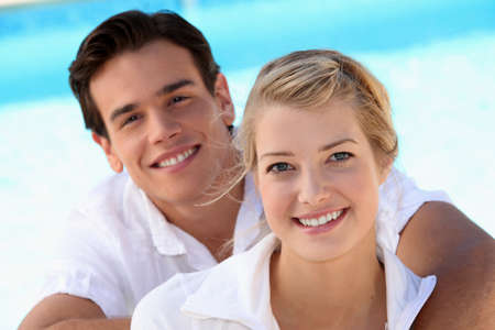 soul mate: Smiling young couple with a blue sky background Stock Photo