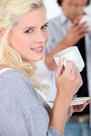 platinum hair: Young woman with a hot drink