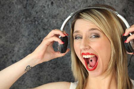 Woman having fun singing loudly photo