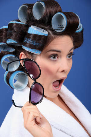 hairdress: A stunned brunette with hairrollers on.
