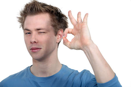 ideal: student making an okay sign