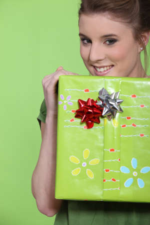 Woman holding a big wrapped package. photo