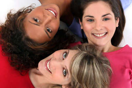 top model: Three female friends laying together