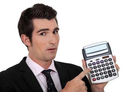elegant businessman presenting calculator photo