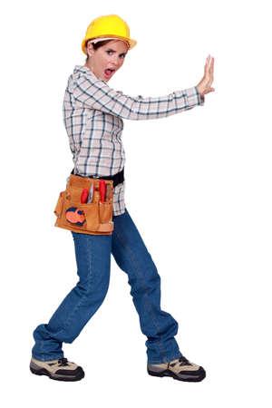 ultimatum: Woman pushing against an imaginary wall Stock Photo