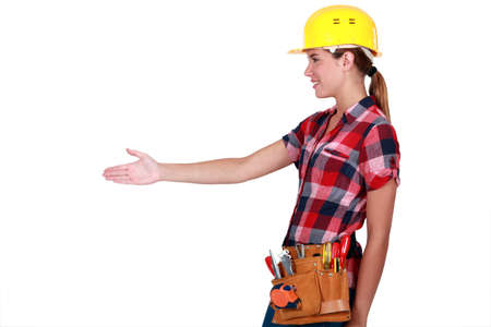A female construction worker about to shake hands. photo