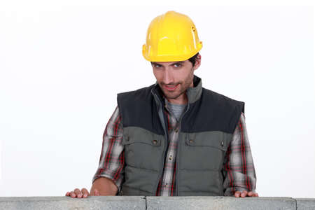 Shy worker behind wall photo
