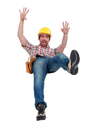 person falling: craftsman slipping and falling Stock Photo