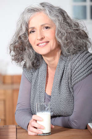 Older woman with a glass of milk Stock Photo - 10855107