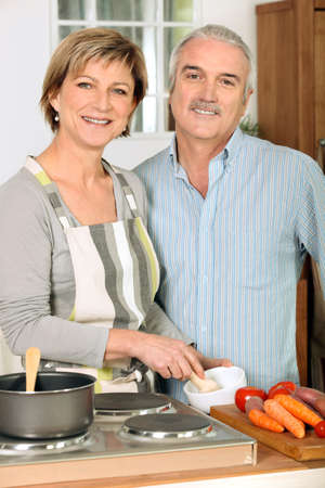 Portrait of a woman cooking with her husband photo