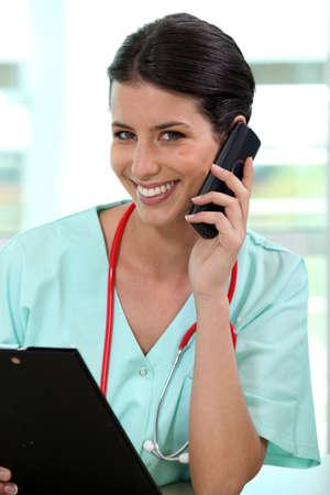 health answers: nurse talking on the phone Stock Photo