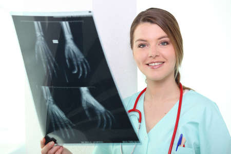 Nurse smiling with X-ray Stock Photo - 10852552