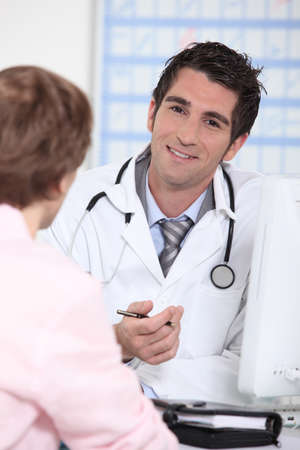 Doctor in appointment with patient Stock Photo - 10853370