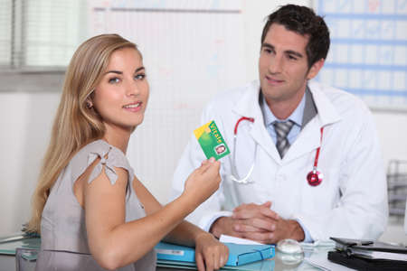 men health: Teenager showing French health insurance card