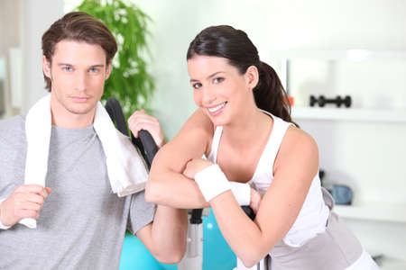 cross armed: young couple in sports room Stock Photo