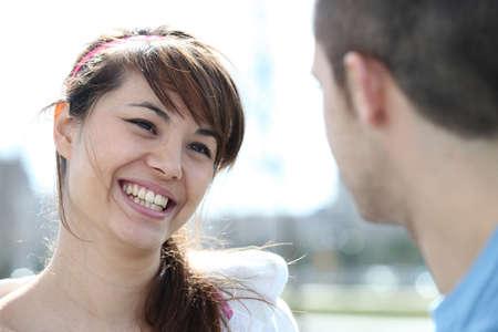 heartbreaker: Smiling woman talking to a man