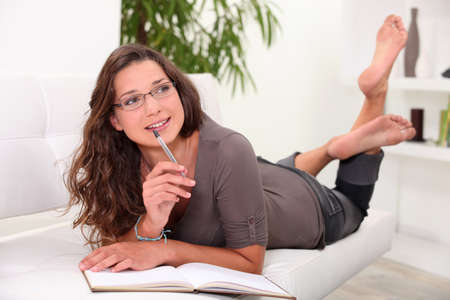 a young woman writing on a notebook Stock Photo - 10853087