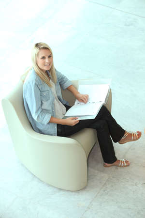 Blond teenager revising photo