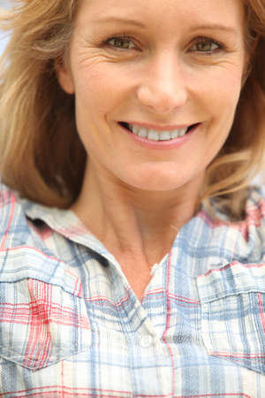 late thirties: Closeup of a woman in her late thirties Stock Photo